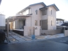 ひとつに絞った外壁、塀、アプローチ&車庫の床のカラースキム。 施工例5