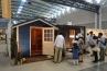 北海道の木材工事、国政建材メーカー山田木材ブースでは、オリジナルブランドのJOYWOOD 木製物置を展示。青いモデルは北海道産松を用いたPITCHというタイプ。