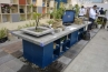 テーブルには、御影石やボルケーノを加工した水鉢・水盤など。透水性多孔質コンクリート材ポーラスの素材紹介ほか、ピンコロも置いてありました。
