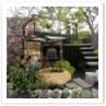 鬼瓦を配置したモダンな雰囲気のお庭。