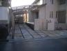 住宅外壁と調和させたタイルとブラウンのブロック、ベージュの洗い出し仕様。施工例2
